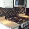 Black tile backsplash kitchen